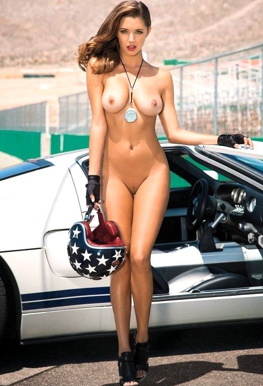 naked girl next to race car