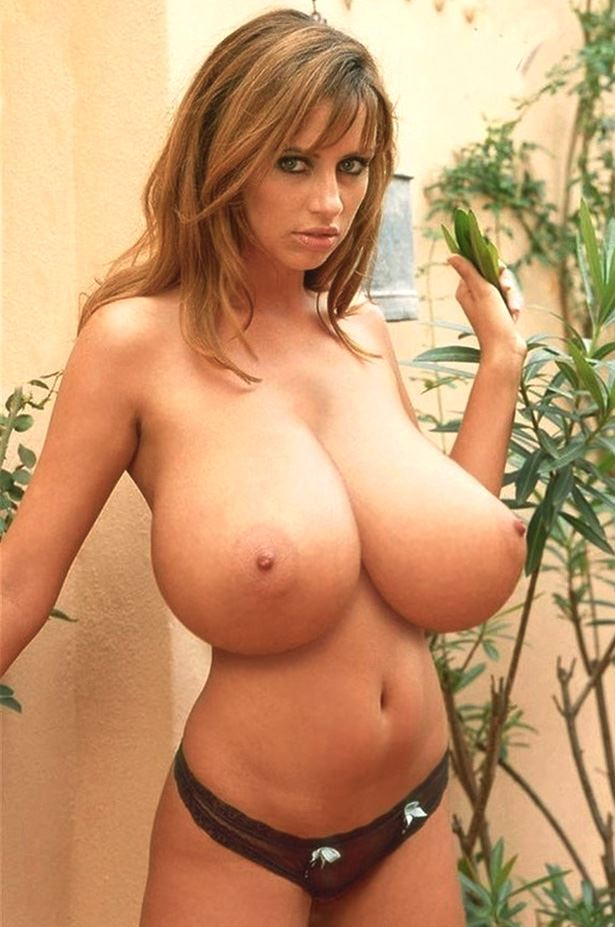 busty photo model posing