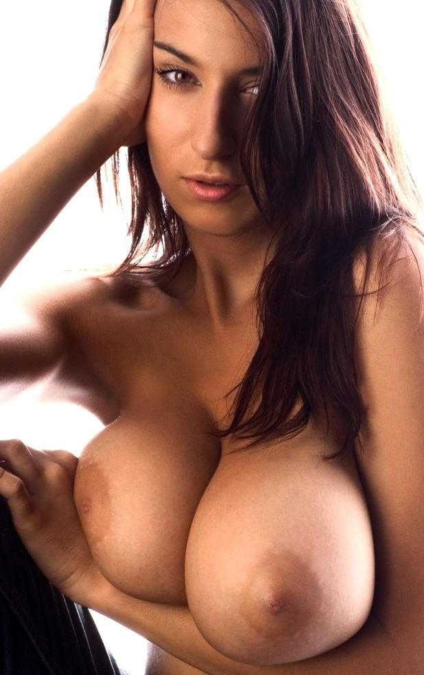 brunette with huge tits on hand