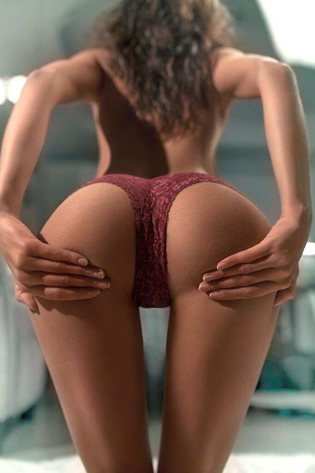 skinny girl shows her ass in panties