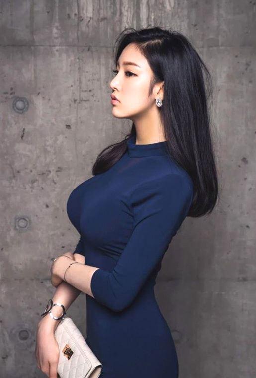 busty asian in dress