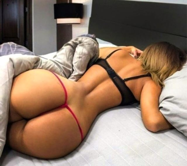 sleeping girl shows her ass with red thongs