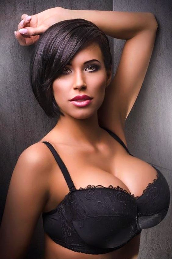 brunette busty model wearing black bra