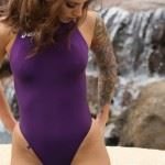 hot girl in purple swimsuit