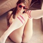 smilling college girl shows pussy while wearing socks