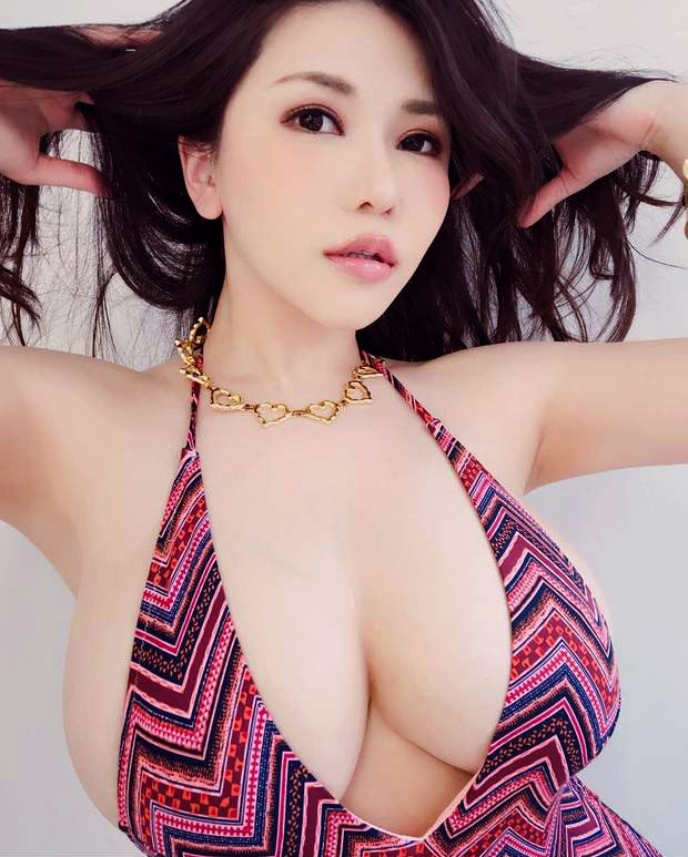 busty asian girl in purple dress and necklase