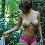 girlfriend getting undressed in the wilderness