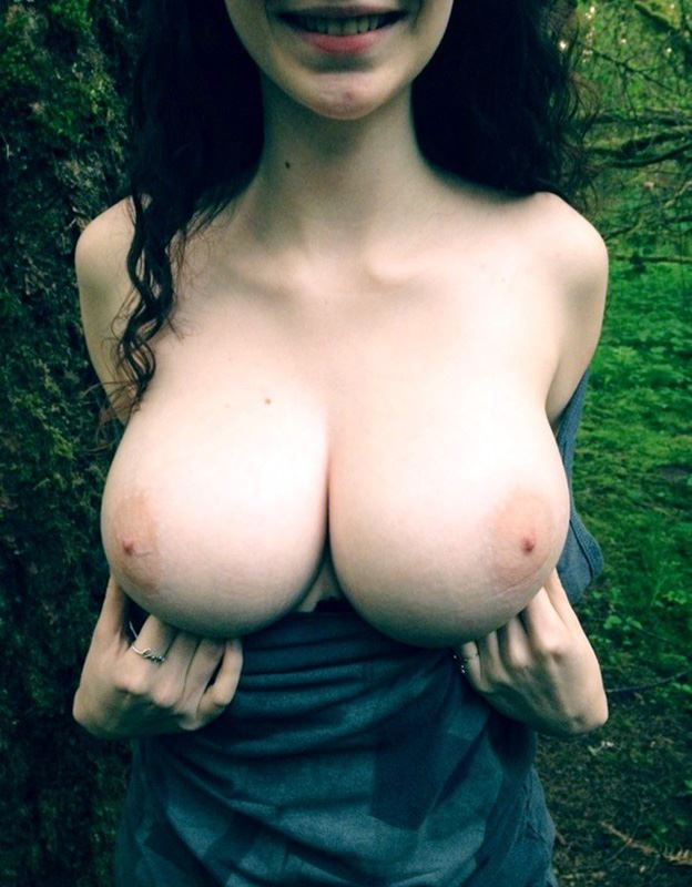 amateur girl shows her big tits in woods