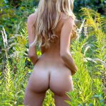 slim blonde ass from behind in nature