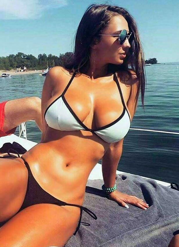 amateur hot brunette with big tits on the boat