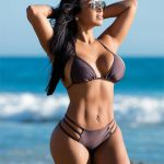 Dolly Castro by the ocean
