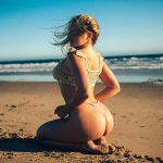 Courtney Tailor on beach and her ass