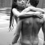 young couple have sex in water