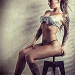 christy mack punk hair sitting on chair