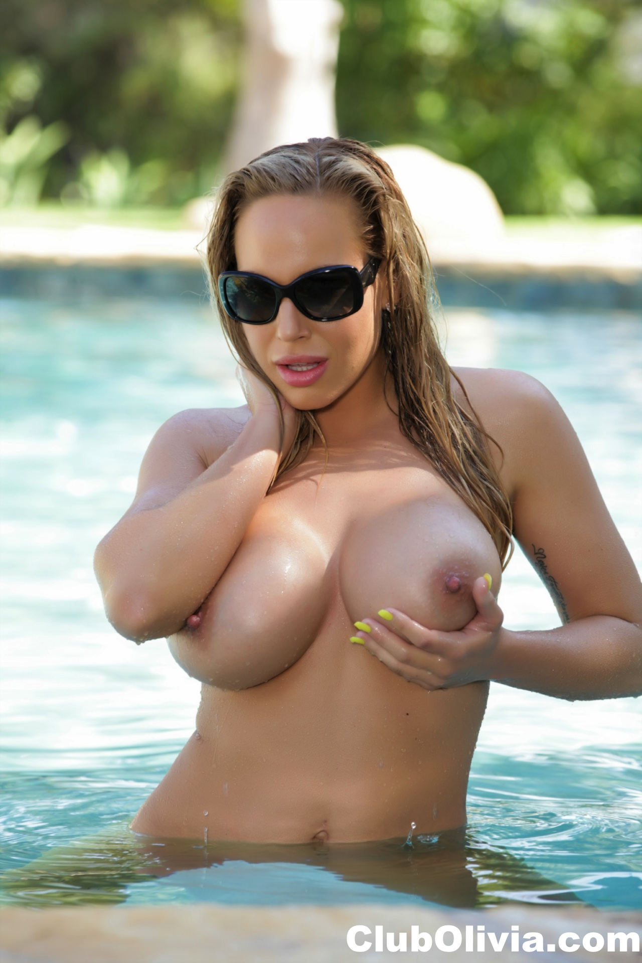 Gallery: Olivia Austin getting her big tits naked by the pool